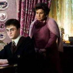 Harry in Umbridge's office doing lines